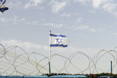 Israeli flag and barbed wires. Border between Israel and Lebanon Stock Image