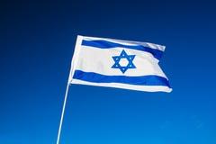 Israeli flag closeup. On background blue sky royalty free stock image