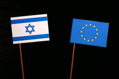 Israeli flag with European Union EU flag  on black. Background Royalty Free Stock Photography