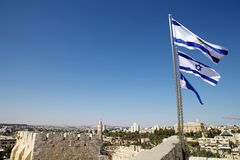 Israeli flag. S are waving over the David's Citadel with Jerusalem town in the background, Jerusalem, Israel royalty free stock photos