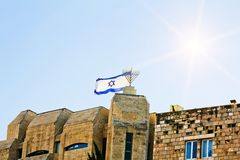 The Israeli flag flies over old Jerusalem amid sunny skies Royalty Free Stock Photography