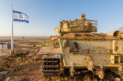 Israeli flag flying beside an Israeli tank from the Yom Kippur War at Tel Saki on the Golan Heights. Israeli flag flying beside a decommissioned Israeli stock photos