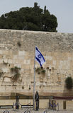 Israeli Flag in front of the Western Wall in the Old City of Jerusalem. Royalty Free Stock Photo