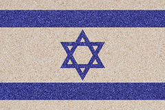 Israeli flag made of colored decorative sand. Royalty Free Stock Photography