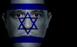Israeli Flag - Male Face. Israeli flag painted/projected onto a man's face Royalty Free Stock Image