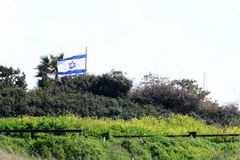 Flag fluttering in the wind. Israeli flag with a six-pointed star fluttering in the wind stock photo
