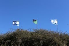 Flag fluttering in the wind. Israeli flag with a six-pointed star fluttering in the wind royalty free stock photo