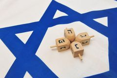 Israeli Flag with Wooden Dreidels Royalty Free Stock Photo