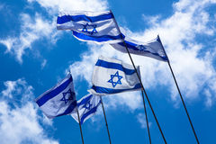 Israeli Flags. In the sky royalty free stock photography