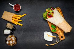 Israeli Food Shawarma on Copy Space. Israeli Food with Shawarma Rolled Sandwich and Fried Potatoes with Cola on Copy Space stock image