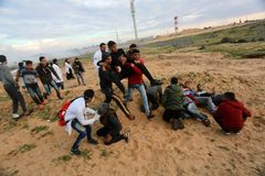 Israeli forces intervene in Palestinians during a the demonstrations near Gaza-Israel border, in the southern Gaza Strip royalty free stock image