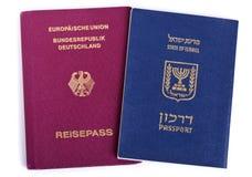 Double Nationality - Israeli & German. Israeli and German passports isolated on white background Royalty Free Stock Photography