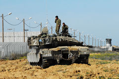 Israeli IDF Tank - Merkava. KEREM SHALOM, ISR - FEB 04:Israeli soldiers on Merkava tank on FEB 04 2009.It's IDF battle tank used designed for rapid repair of Royalty Free Stock Photos