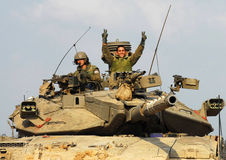 Israeli IDF Tank - Merkava. NACHAL OZ, ISR - NOV 12:Israeli soldiers on Merkava tank on NOV 12 2008.It's IDF battle tank designed for rapid repair of battle Royalty Free Stock Photography