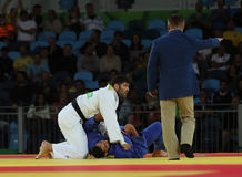 Israeli Judoka Ori Sasson in white won men +100 kg match with Egyptian Islam El Shehaby of the Rio 2016 Olympic Games Royalty Free Stock Photo