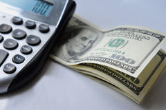 Israeli Money and Economy. Calculator with American hundred dollar bills isolated on white Royalty Free Stock Photos