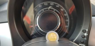 New shekels coin of 10 on sport car speedometer dashboard stock images