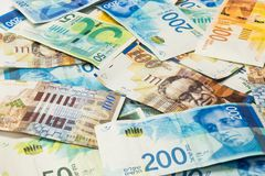 Israeli money stack of new Israeli banknotes of different value in shekels NIS stock photo