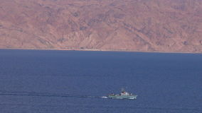 Israeli Navy boat patrolling in the Gulf of Eilat, Israel. EILAT, ISR - APRIL 15 2015:Israeli Navy boat patrolling in the Gulf of Eilat, Israel.Israel Defense stock footage