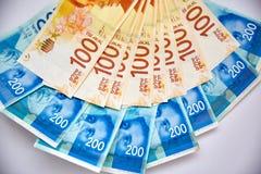 Israeli New Shekel Money Bills Fall on Table.  royalty free stock photography