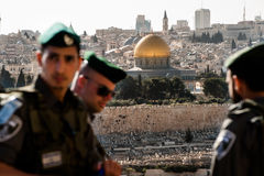 Israeli occupation in Jerusalem. Israeli soldiers occupy a street overlooking the Dome of the Rock and the Old City of Jerusalem during the annual Palm Sunday royalty free stock image