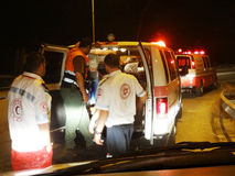 Israeli - Palestinian cooperation. Israeli - Palestinian Rescuers cooperation saving life of a car accident Wounded Magen David adom and the red Crescent stock photos