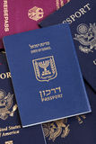 Israeli Passport on Passports Stack. An Israeli passport resting on a stack of American and German passports Royalty Free Stock Photography
