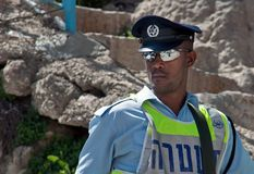 Israeli patrol policeman on Hebron Street. HEBRON, ISRAEL- MARCH 30, 2010: Israeli patrol policeman on Hebron Street Royalty Free Stock Photo