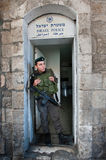 Israeli Police in Jerusalem. JERUSALEM - APRIL 21: An Israeli border policeman stands in the doorway of his station in the Old City of Jerusalem stock photography