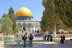 Israeli police and muslims at the entrance in Dome of the Rock, Jerusalem. JERUSALEM, ISRAEL - June 15, 2017: israeli police keep order on the Temple Mount, Old Royalty Free Stock Photography