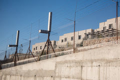 Israeli separation barrier and settlement in occupied Palestinian territory. The Israeli Separation Wall encircles the settlement of Har Gilo on land belonging Stock Photography