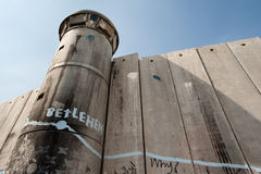 Israeli Separation Wall. BETHLEHEM, OCCUPIED PALESTINIAN TERRITORIES - Activist graffiti adorns the Israeli separation wall and watch tower in the West Bank town Royalty Free Stock Images