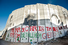 Israeli Separation Wall in Bethlehem. BETHLEHEM, OCCUPIED PALESTINIAN TERRITORIES - DECEMBER 16: Graffiti on the Israeli separation wall in the West Bank town of Stock Photo