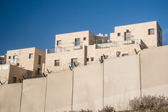 Israeli separation wall and settlement in occupied Palestinian territory. The Israeli Separation Wall encircles the settlement of Har Gilo on land belonging to Stock Photography