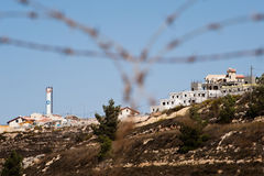 Israeli Settlement. NEVE DANIEL, OCCUPIED PALESTINIAN TERRITORIES - OCTOBER 15: A tower bearing the Star of David rises above Jewish homes in the Neve Daniel Stock Photos