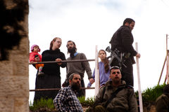Israeli settlers and soldiers in Hebron. HEBRON, OCCUPIED PALESTINIAN TERRITORIES - FEBRUARY 26: Israeli settlers and soldiers occupy rooftops above Palestinian Royalty Free Stock Photography