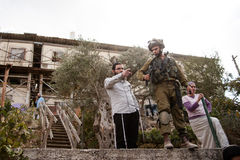 Israeli settlers and soldiers in West Bank Stock Photo