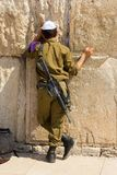 Israeli soldier. Prays at the western wall. Jerusalem, Israel royalty free stock photo