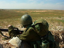 Israeli soldier. Exercise with a rifle and helmet Stock Images