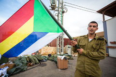 Israeli soldier with Druze flag. Mount Carmel, Israel - October 28, 2015: Israeli soldier with Druze flag. Group of them was installing Israeli flag before Stock Photo