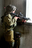 Israeli soldier looks through a gun-sight Royalty Free Stock Photo