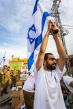 Israeli soldier with national flag Stock Photos