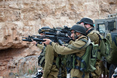 Israeli soldiers aim guns Stock Photos