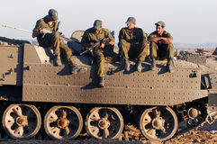 Israeli soldiers on armed vehicle. NACHAL OZ, ISR - JULY 06 2006:Israeli soldiers on armed vehicle .IDF is one of Israeli society's most prominent institutions Royalty Free Stock Image