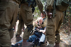 Israeli soldiers arrest international activist Stock Photography