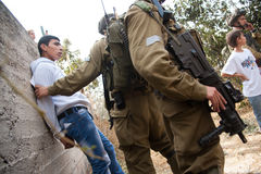 Israeli soldiers arrest Palestinian Royalty Free Stock Image