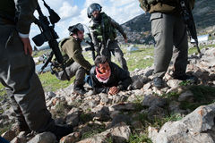 Israeli soldiers arrest Palestinian Royalty Free Stock Photos