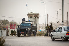 Israeli soldiers checking Palestinians Stock Photo