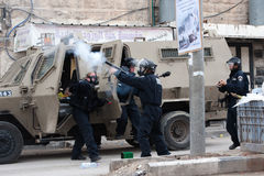 Israeli soldiers fire tear gas. HEBRON, OCCUPIED PALESTINIAN TERRITORIES - FEBRUARY 24: Israeli troops fired tear gas at thousands of Palestinians marching to Stock Images