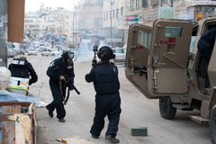 Israeli soldiers fire tear gas. HEBRON, OCCUPIED PALESTINIAN TERRITORIES - FEBRUARY 24: Israeli troops fired tear gas at thousands of Palestinians marching to Royalty Free Stock Photo